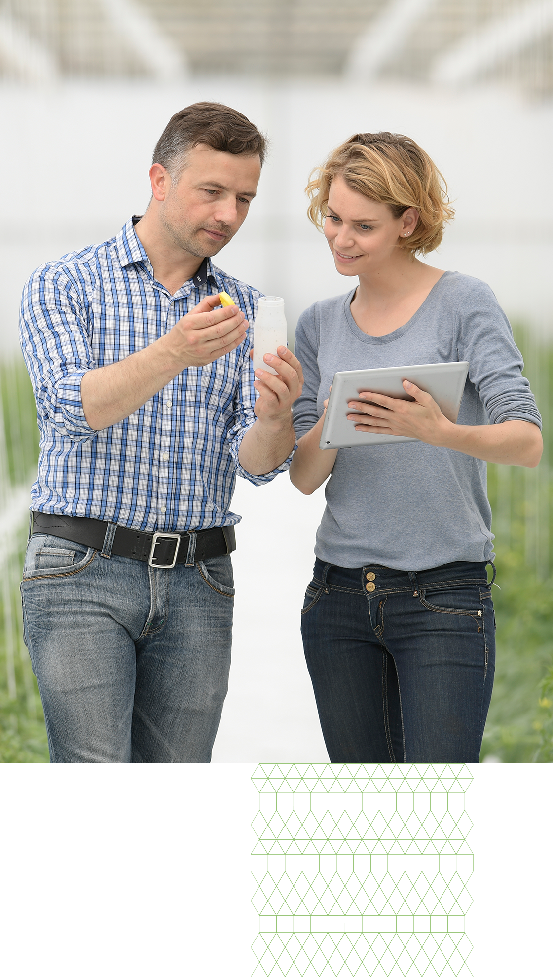 Male and Female using CropTrak on an Ipad