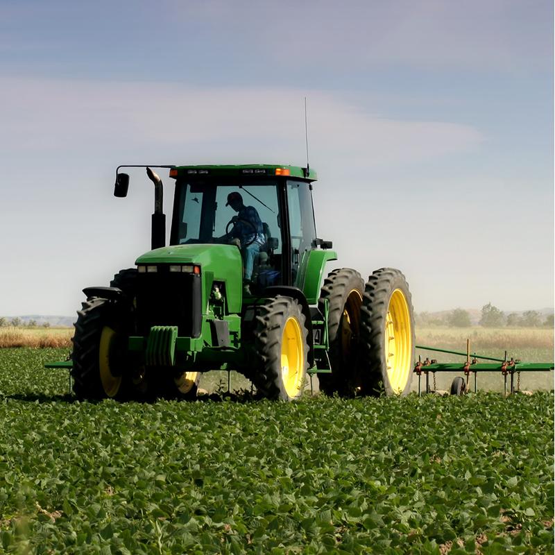 Green John Deere Tractor in Field